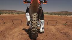 Motocross Rider Flicks Dirt at Camera 200FPS Stock Footage