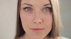 Beautiful young girl has mysteriously looks into the camera - stock footage
