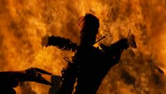 Voodoo doll fire silhouette cursed Stock Footage