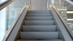 Empty escalator stairs moving up with logo warning - stock footage