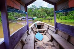 Purple Canoe on the Amazon River - stock photo