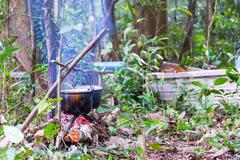 Campfire Cooking in the Amazon - stock photo