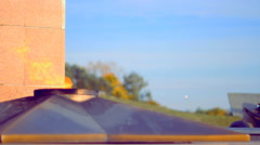 Eternal flame on the monument to unknown soldier of World War II Stock Footage
