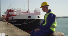 Portrait of a dock worker standing at the harbor. Stock Footage
