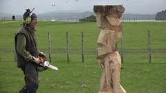 Wood sculpture sculpting a statue with a chainsaw Stock Footage