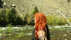 Caveman lake river primative man water Stock Footage