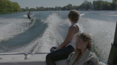 Extreme Sport - Wake Board rider doing tricks behind the boat Stock Footage