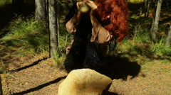 Caveman smashing rocks rock tool making primitive man Stock Footage