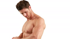 Muscular man flexing his muscle - stock footage