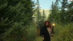 Caveman with torch holding hold Stock Footage