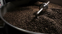 Traditional coffee roaster cooling of fresh roasted coffee beans Stock Footage