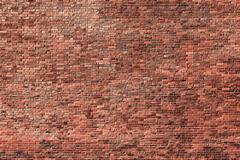 Old brick wall in grunge style as a background - stock photo