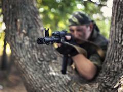 Soldier shooting from a Kalashnikov closeup Stock Photos