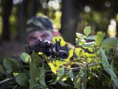 soldier shooting from a Kalashnikov ambush - stock photo