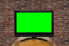 Modern Television with Chroma Key Green Screen and Red Brick Wall Kuvituskuvat