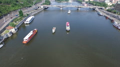 Aerial view of Vltava River with boats, in Prague Stock Footage
