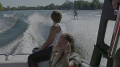 Young people having fun on a boat in the summer - Vacation lifestyle Stock Footage