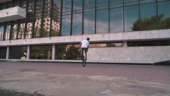 BMX rider doing tricks in the city, slow motion, dolly shot - stock footage