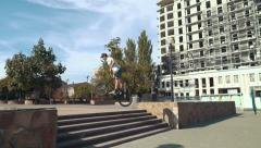 BMX rider doing tricks in the city, slow motion, steadycam - stock footage