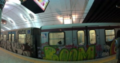Undeground train with graffiti leaving station Stock Footage