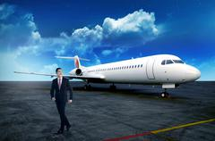 Asian business person walking from airplane after landing Kuvituskuvat