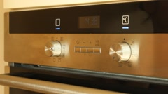 Setting time of an electric Stove - stock footage