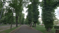 WWalking and riding bikes in Central Park, Cluj-Napoca Stock Footage
