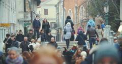 Venetian street view with people walking across the bridge Stock Footage