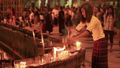 Lighting Candles Shwedagon Temple - stock footage