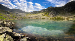 Mountain lake with reflection on the smooth water. Stock Footage