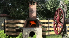 Baking bread in a traditional wood fired stone oven - stock footage