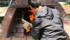 Wood fire in a traditional bread oven Stock Footage