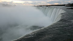 The falling water of Niagara Falls in the early morning pulls into the depth Stock Footage