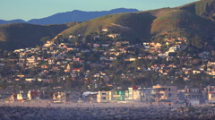 The hillside town of Ventura, California shines in sunset light. Stock Footage