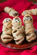 Funny meatballs sausage mummies in dough scary halloween celebration party food - stock photo