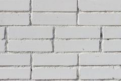 Stock Photo of Background texture of a old white brick wall