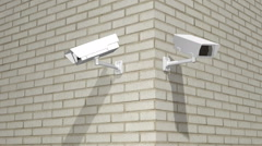 A Zoom Into Two Exterior Security Cameras - stock footage