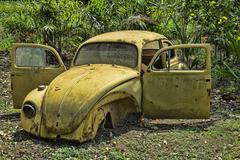 Abandoned VW Beetle - stock photo