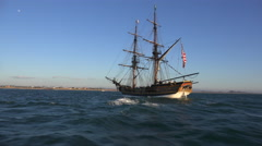A tall historic clipper ship sails on the ocean. Stock Footage