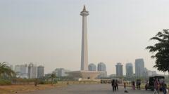 People making selfie with Monas monument,Jakarta,Java,Indonesia Stock Footage