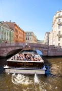 Stock Photo of Tourist boat goes through the channel in St. Petersburg, Russia