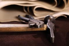 The composition of brown and vanilla leather and shoe accessories - stock photo
