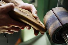 Elegant but masculine, manual precision work shoemaker Stock Photos