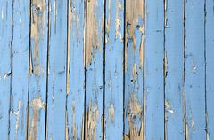 Wall made of light blue wooden slats paint peeling off - stock photo