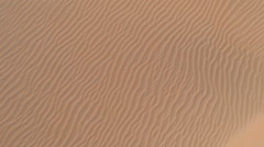 Drone shot looking down on corrugations on sand dune Stock Footage