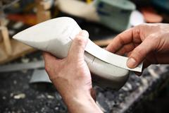 Stock Photo of Shoemaker's workshop, append heels