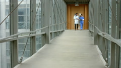 Doctors talking in the hallway Stock Footage