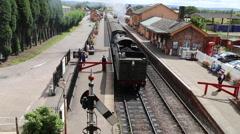 Steam train leaving Bishops Lydeard Somerset UK Stock Footage