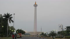 Monas late in afternoon with lightened up flame,Jakarta,Java,Indonesia Stock Footage