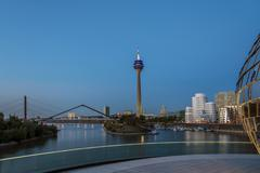 Rhine Tower and city harbor at dusk Dusseldorf North RhineWestphalia Germany Stock Photos